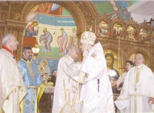 Metropolitan PHILIP greets the newly enthroned bishop ALEXANDER (Click to enlarge)