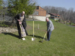 Fr. Michael Massouh, Antiochian Village Executive Director, and Bob Laham, Village Council Chairman, turn the first shovels