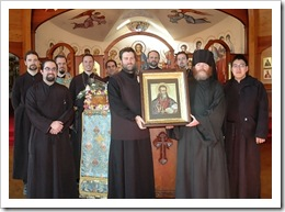Leaders of the various OISM groups gather around an icon of St. John