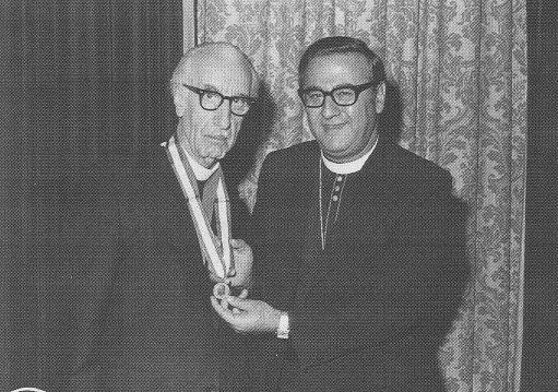 Bestowing the Antonian Gold Medal on Protosyngellos Ellis Khouri