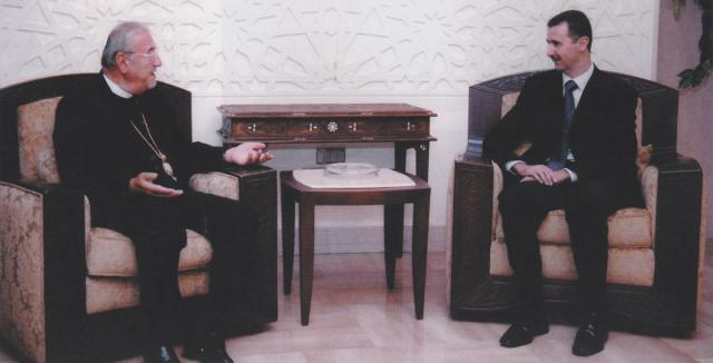 With Syrian President Dr. Bashar Al-Assad in Damascus in 2004
