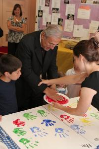 Adding his handprint at St. George Church in Bridgeville, PA