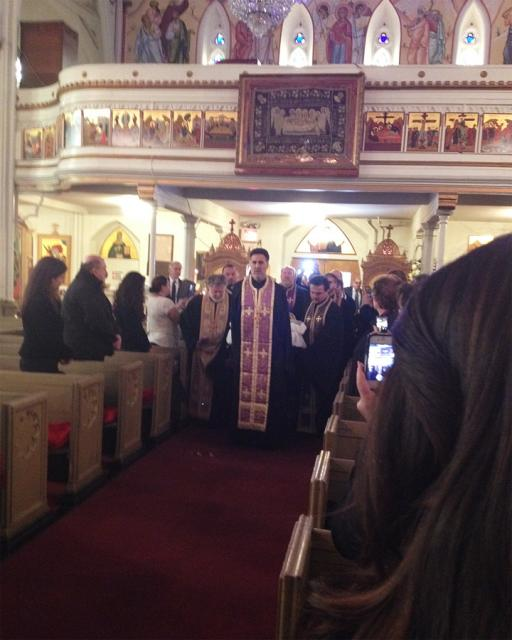 His Eminence is brought into St. Nicholas Cathedral