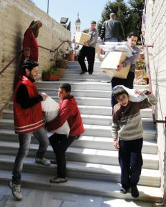 Displaced Syrian youth fill their days volunteering for IOCC and relief partner GOPA (Photo: GOPA)