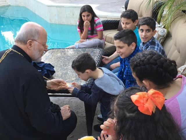 Metropolitan Joseph with children in Los Angeles, February 21, 2016