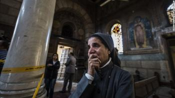A nun reacts as Egyptian security forces inspect the scene of the bomb explosion. (Khaled Desouki/Getty Images)