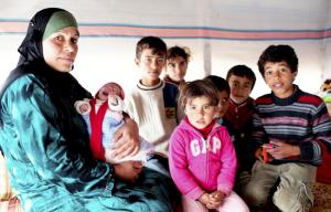 Syrian refugee Samira with her six children (Photo: Sarah Malian/Christian Aid)