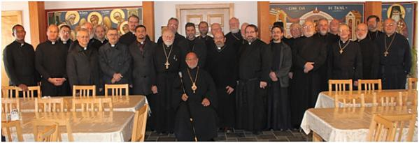Bishop Thomas and the clergy pose for a commemorative photo in the Monastery refectory