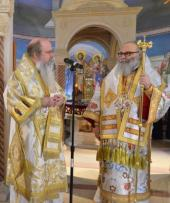 Metropolitan Tikhon presenting gifts to Patriarch John X, December 2014