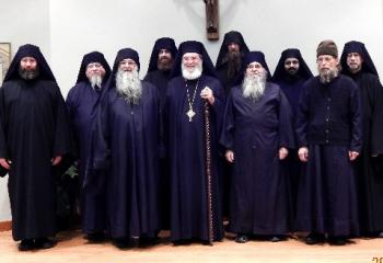 Father Bartholomew (third from the right).