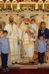His Eminence with Fr. Michael Corbin and family