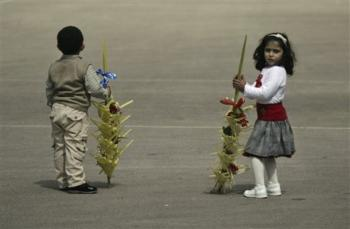 Palestinian Orthodox Christian children hold palm fronds on Orthodox Palm Sunday in the West Bank city of Ramallah, Sunday March 28, 2010.