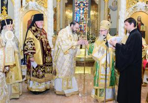 His Grace is presented with the Episcopal Staff. (Photo: Dimitrios Panagos)