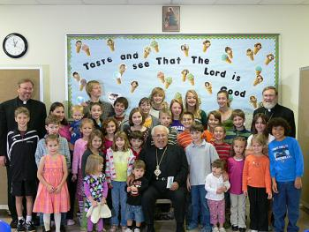 His Grace, Bishop +ANTOUN, poses with the children of All Saints Orthodox Church in Raleigh, NC, after enjoying lunch and a Q&A session with them.