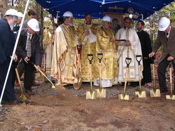 His Grace, Bishop +ANTOUN, sprinkles Holy Water on the site of the new temple and education building for All Saints Orthodox Church in Raleigh, NC.