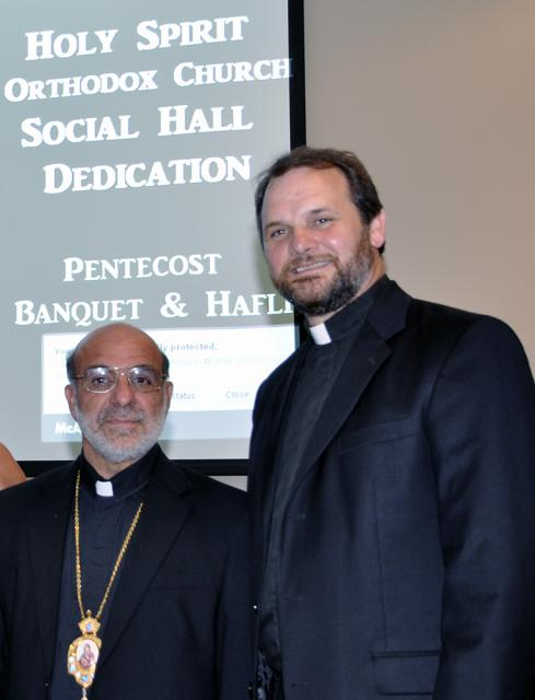 Bishop THOMAS and Fr. Dixon at the banquet.
