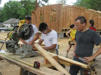 IOCC volunteer Michael Kostaras, 17 (center), joined his father Jim and 12 other Orthodox Christians to help build new homes for families in St. Tammany Parish, Louisiana. (photo: IOCC Baltimore)
