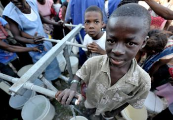 Homeless families in the Belair neighborhood of Port-au-Prince who survived Haiti's devastating January 12 earthquake enjoy safe water provided through a water system installed by Norwegian Church Aid with the support of IOCC.