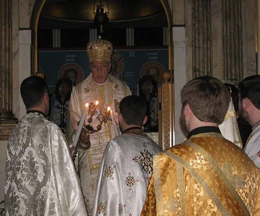 Metropolitan PHILIP bearing the Paschal Flame