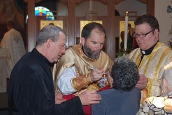 The newly ordained Fr. Raphael Barberg giving Holy Communion