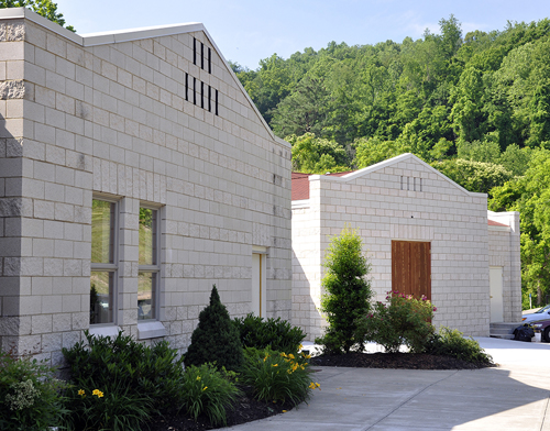 The portion to the right is the new social hall / Sunday School annex.  It blends seamlessly with the current motif.