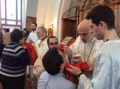 His Grace Bishop Alexander serves Holy Communion during the Divine Liturgy at St. Nicholas Church in Montreal, Quebec.