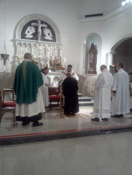 Fr. Mark blesses Bishop Thomas