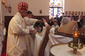 L to R:  Bishop Thomas; Fr. Samuel Haddad receiving the cross at his Elevation to Archpriest; Abbott Seraphim, Hermitage of the Holy Cross Monastery