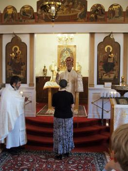 Bishop Thomas installs Annie Cardell as the new parish treasurer