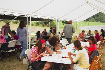 Parishioners enjoying the barbecue fare under the tents