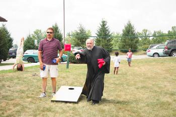 Parish Council President Larry Steele and Fr. Ted competing at the bean-bag toss