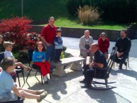 His Grace Bishop Thomas visiting with parish kids