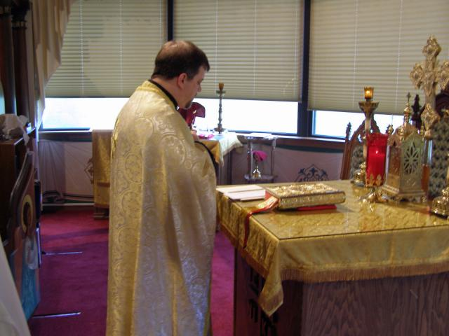 09: Fr. Gregory Long in the altar of Sts. Peter and Paul