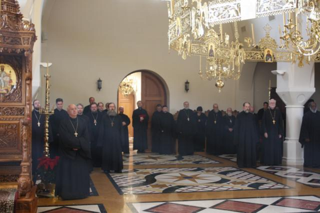 Clergy worshipping in monastery church