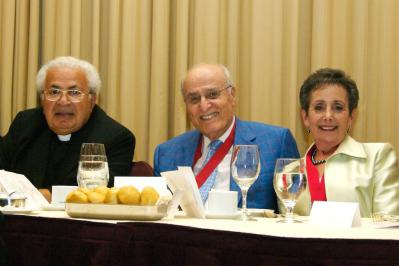 Bishop Antoun joins the Farhas at the award dinner
