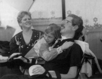 Dn. Philip with his wife, Kim, and daughter, Emily, at a community fundraiser held for his benefit on April 16, 1997.