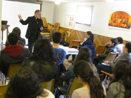 Teens listen intently to Fr. Joseph's presentation