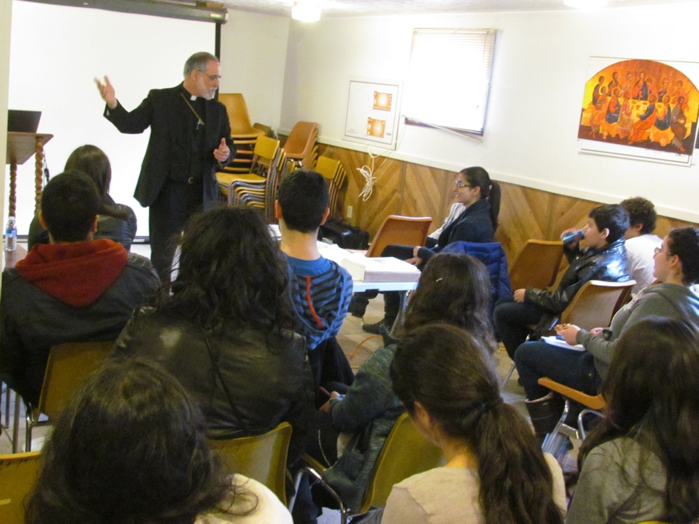 Teens listen intently to Fr. Joseph Purpura, Halifax