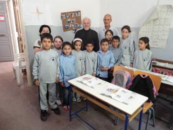 Fr. Jason with children and staff members at the elementary school in Fih,  Lebanon, established by Jacob Hyder