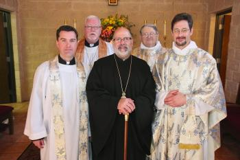 Fr. Mark, Bishop John and Fr. Robert; back, Fr. Michael Kaiser and Rev. Dn. George Palmer.