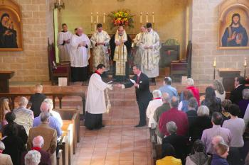 Fr. Mark receives the keys to St. Peter's Sanctuary from Kent Schmedel.