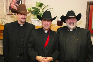 From left, Fr. Robert, already an official Texas resident, is joined by Fr. Mark and Bishop John, our honorary Lone Star citizen.