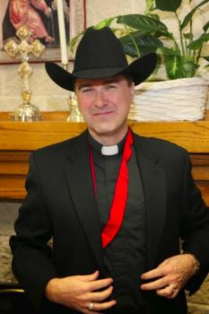 "Fr. Mark becomes an ""official"" resident of ""Cowtown, USA."""