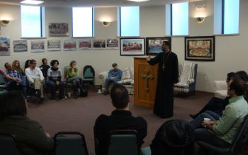 Fr. Alexis Kouri, Diocese FSJD Spiritual Advisor, speaking to the group