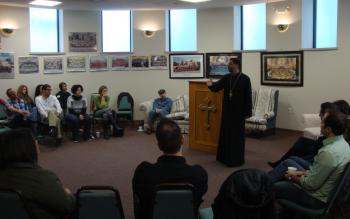 Fr. Alexis Kouri, Diocese FSJD Spiritual Advisor, speaking to the group