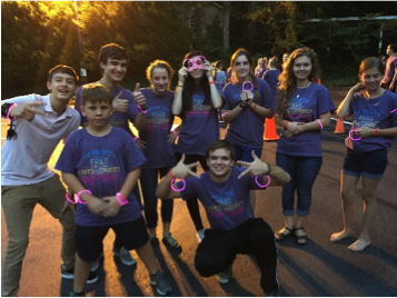 The pink team during Glow in the Dark Capture the Flag
