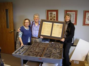 Carol and Paul Swydan present their donation to museum curator Julia Ritter; November 2010.