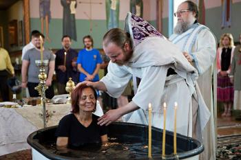 Fr. Justin Havens of Ss. Peter and Paul Antiochian Orthodox Church of Salt Lake City, Utah baptizes new Orthodox Christians on Holy Saturday, 2014.