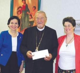 President Violet Robbat and Vice President Dianne O'Regan present check for 2012 project to His Eminence Metropolitan Philip of blessed memory