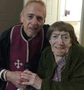 Fr. John Hamatie brought Holy Communion to Selwa on her 95th birthday